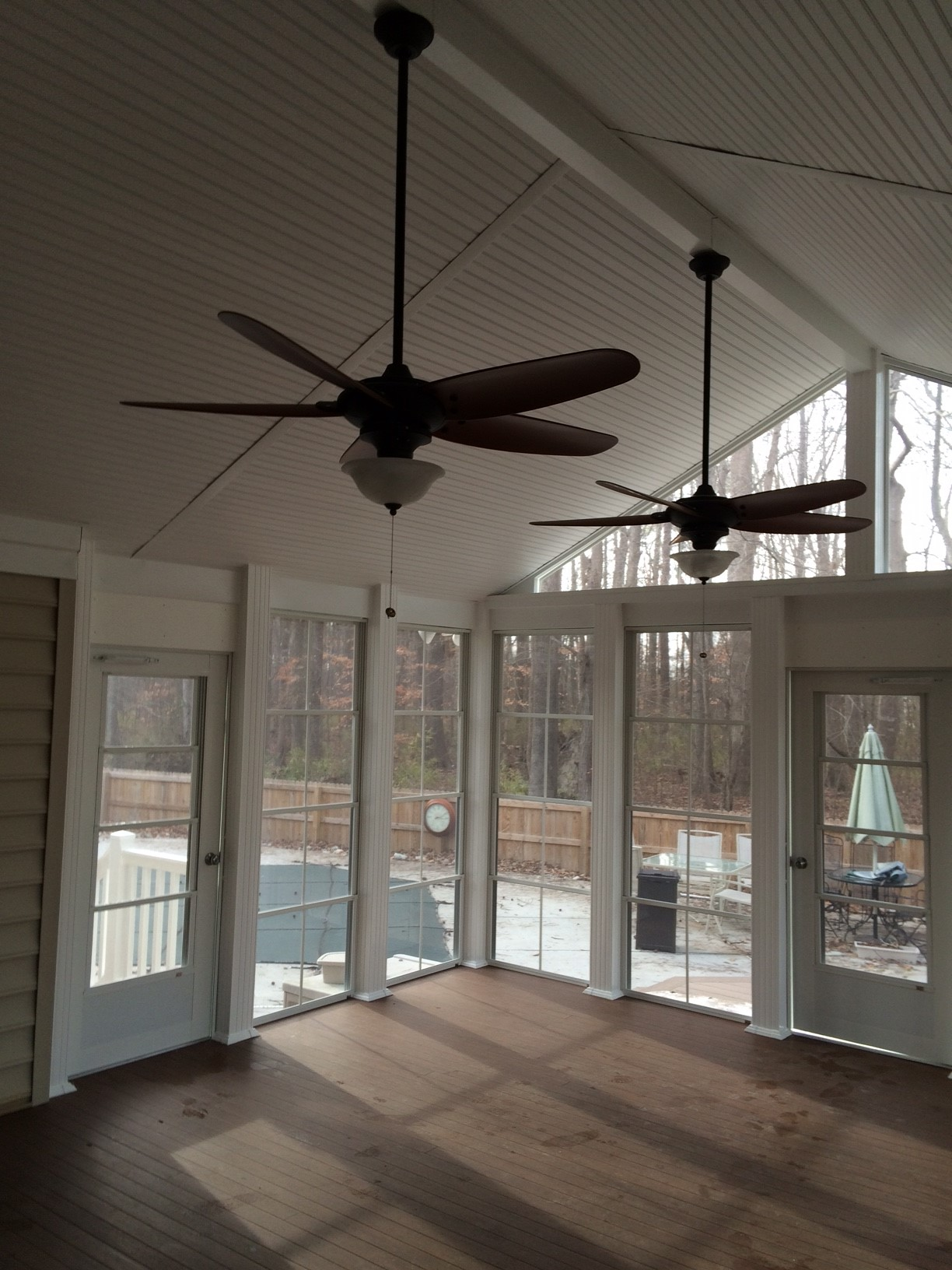 Sun room porch with ceiling fans